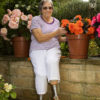 Gardening Granny bitten by bug while gardening later on loses legs, fingertips