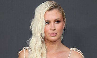 Gardening Ireland Baldwin plays gardener in plunging swimsuit