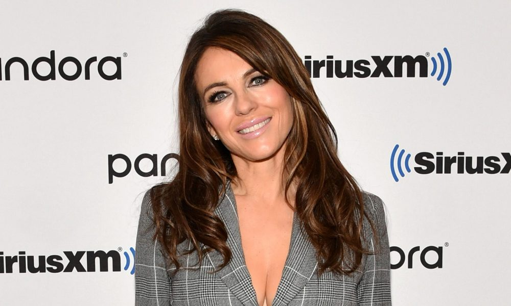 Gardening Elizabeth Hurley stuns as she re-wears renowned Versace gown from 21 years ago: 'Just hanging in the house'