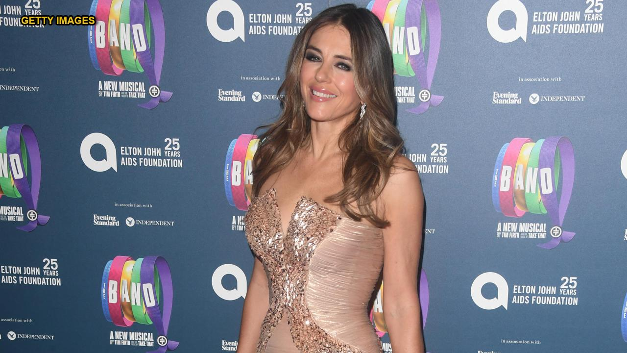 Gardening Elizabeth Hurley, 54, shares throwback swimwear breeze while in isolation: 'No I'm not in the Maldives'